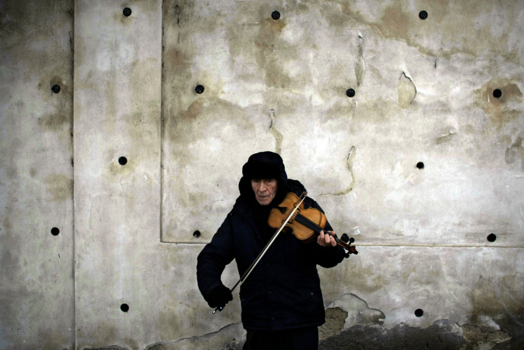A violinist on a street in Prague, where thousands of Czechs gathered on Friday for the funeral for former President Vaclav Havel. Author: Marko Drobnjakovic/Associated Press
